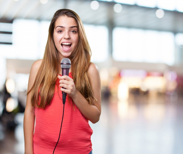 young-woman-singing-with-a-microphone-on-white-background_1149-1984